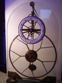 Reproduction great wheel skeleton clock, Front view.